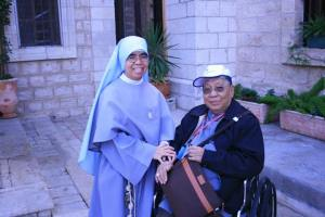 Bishop Gutierrez with a Filipina sister outside the Wedding Church at Cana in Galilee