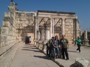 The group, at the back is the Old Synagogue in Capharnaum