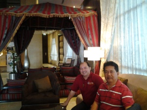 Me and Fr. Estong in Grand Belle Vue Hotel lobby-Dubai checking out