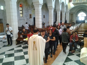 Fr. Roming S. during Holy Communion distribution at st. catherine church