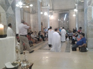 co-pilgrims before the Mass at crusader church